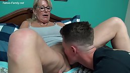 Big titted, blonde woman is having hardcore sex with a younger guy and enjoying it a lot