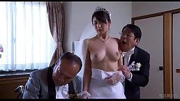 Asian woman is wearing a wedding dress and getting fingered in front of her husband