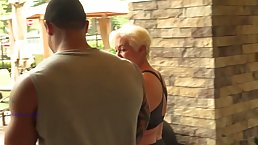 Mature, blonde woman with big, firm tits, Seka had interracial sex with a handsome, black dude