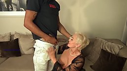 Mature blonde woman with big tits, Seka is having sensual sex with a handsome, black guy