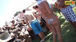 Dirty minded girls are walking around the camp topless while having a party with various guys