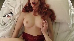 Gorgeous redhead with big boobs is wearing lacy lingerie while gently sucking her boyfriend's dick