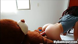 Red haired teen is humping a huge Teddy Bear who is wearing a strap- on and enjoying