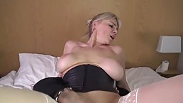 Mature, blonde woman in sexy outfit and white stockings is getting fucked in the ass